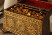 gold nuggets in a ornate box